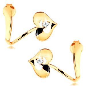 Náušnice ze žlutého 14K zlata - zvlněná stuha, lesklé srdce s výřezem a zirkonem