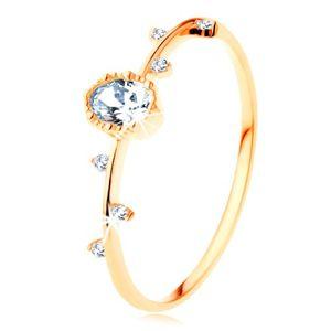Prsten ze žlutého 14K zlata - čirý ovál s vroubkovaným okrajem, drobné zirkonky - Velikost: 54