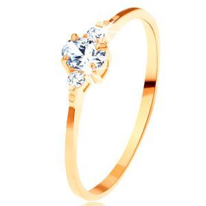 Zlatý prsten 585 - čirý oválný zirkon, malé zirkonky po stranách - Velikost: 57